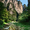 "<h2>Fingers Above River</h2> <br/>This was one of those Tour-de-France days when I burned about 10,000 calories.  I carried my equipment all up and down this valley in Zhangjiajie... up and down each side, traversing the entire length several times, took very few breaks, and ended up sleeping like a baby.  That wasn't a complete sentence...  I know this. <br/><br/>This is just about the same area where I encountered a snake later that night.  It was black and gnarly and did nothing to lift my spirits.  I'll finish that snake story next time I post a photo from this region...  I don't really want to think about it until then!<br/><br/> - Trey Ratcliff <br/><br/>Read more <a href=""http://www.stuckincustoms.com/2011/06/26/fingers-above-river/"">here</a> at the Stuck in Customs blog."