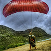 "<h2>A Smooth Landing</h2> <br/>This was a wild last-second shot!  I was driving down the highway along the coast of Oahu with Tom and we saw this area where these parachuters were practicing landing.  Not being a hardcore parachuter (having only done it once!), I didn't really understand that a landing was something one could ""practice"" — I figured you just either landed or you died.  It seemed pretty binary.  Anyway, while there was all this activity, I jumped out there and put my 14-24 on my camera so I could get in close on some of the landings for some fun shots…<br/><br/>- Trey Ratcliff<br/><br/><a href=""http://www.stuckincustoms.com/2012/03/25/a-smooth-landing/"" rel=""nofollow"">Click here to read the rest of this post at the Stuck in Customs blog.</a>"