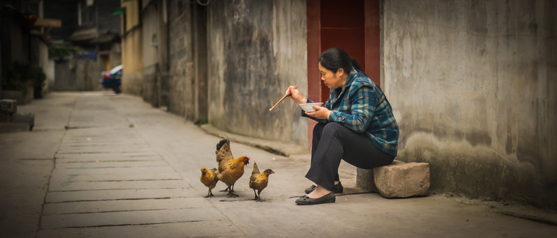 """<h2>Feeding Chooks in Feng Huang</h2> <br/>When in Feng Huang, I decided to go down to the river to take some photos. There was a direct way, but I thought it might be more interesting to zig-zag my way there through alleys. One of the most wonderful things about China is how safe it is. I never had any fear for my life or anything as I move around these places. It's so safe, in fact, that it's almost eerie! But, eerie in a good way, of course…<br/><br/>- Trey Ratcliff<br/><br/><a href=""""http://www.stuckincustoms.com/2013/02/11/feeding-chooks-in-feng-huang/"""" rel=""""nofollow"""">Click here to read the rest of this post at the Stuck in Customs blog.</a>"""