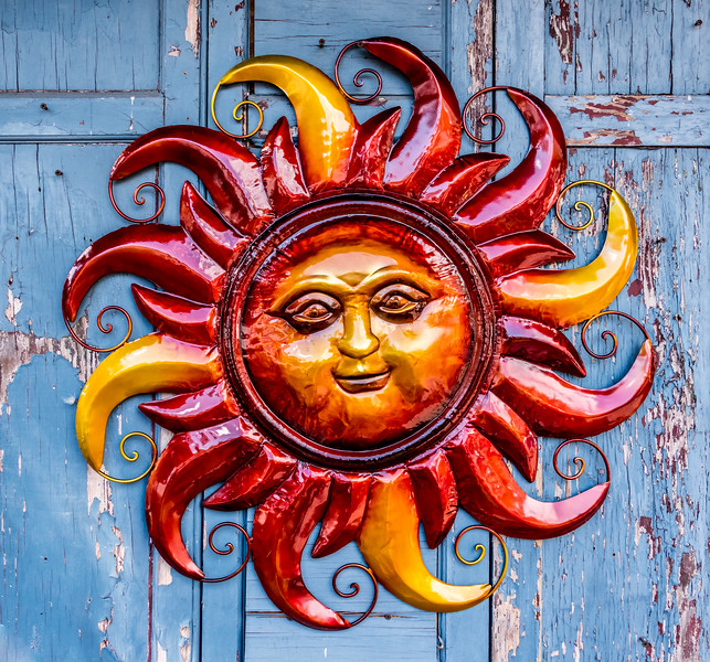 A Colorful Sun Ornament on a Old Door 10/1/17