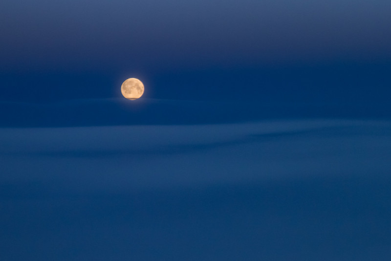 The moon, seen above the clouds from some thirty thousand feet