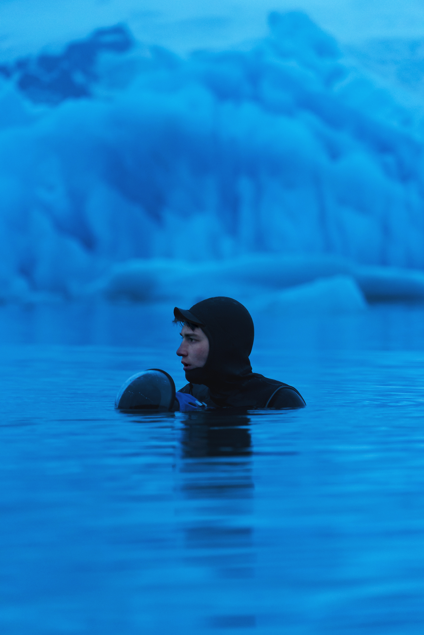 Andrew Studer doing underwater photography of icebergs in Iceland