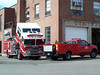 Beverly M1 working on Engine 1's KME outside headquarters.