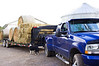 farm truck with trailer, bales, and Border Collie