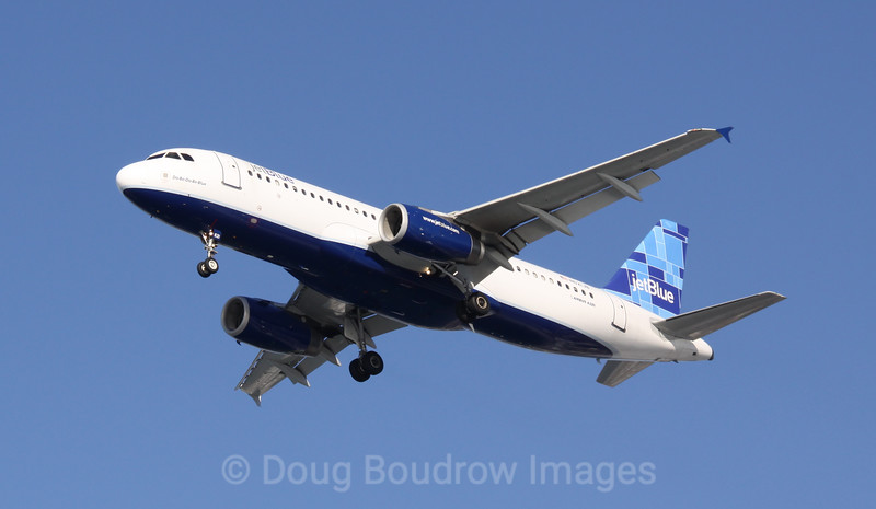 """Jet Blue Airbus A320 """"Do-Be-Do-Be-Blue"""" on final approach to Boston Logan, 1-16-09."""