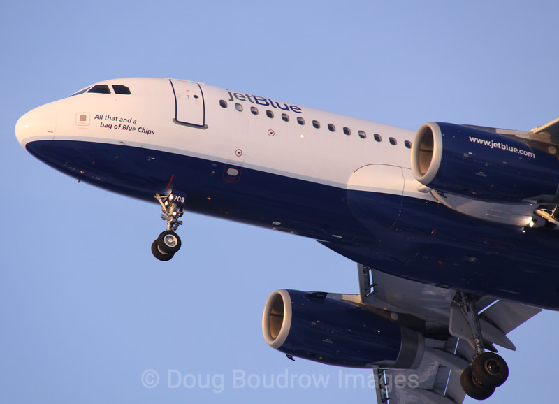 """Jet Blue Airbus A320 """"All That and a bag of Blue Chips"""" on final approach to Boston Logan, 1-22-09."""