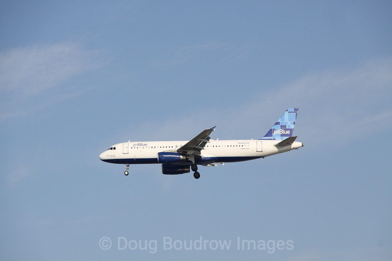 """Jet Blue Airbus A320 """"Honk if You Love Blue"""" on final approach to Boston Logan, 7-6-12"""