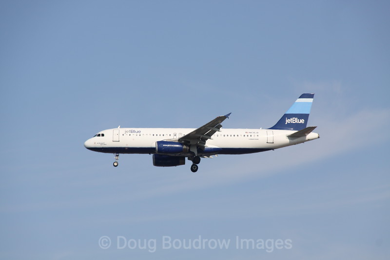 """Jet Blue Airbus A320 """"All Wrapped up in Blue"""" on final approach to Boston Logan, 7-6-12"""