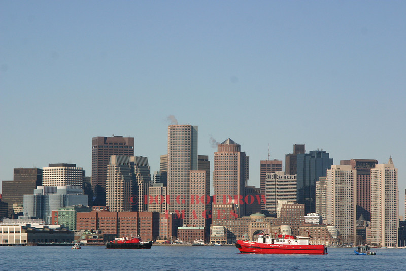 Boston, MA - View towards downtown from the harbor, with Boston and Massport fire boats in the foreground, 3-1-07.