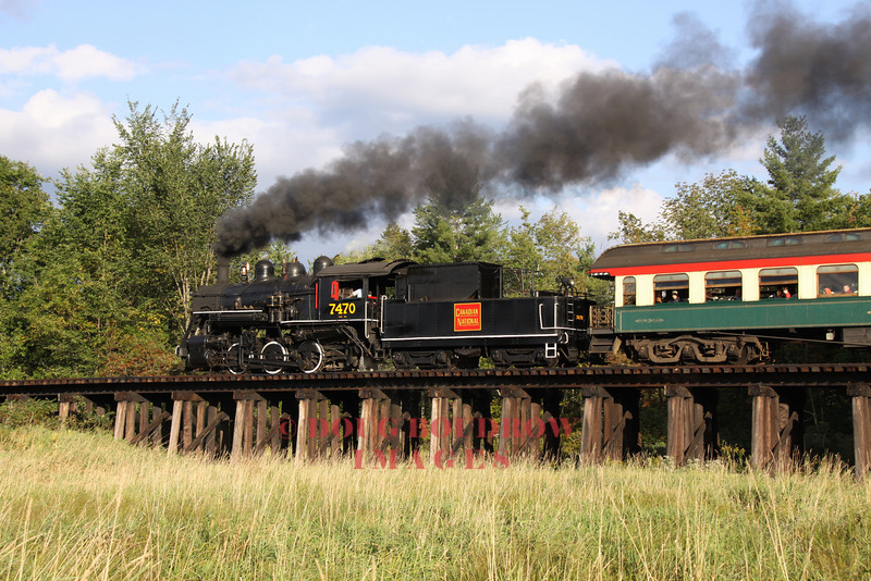 A 1921 steam locomotive crosses Moat Brook Trestle in Conway, 9-19-10.