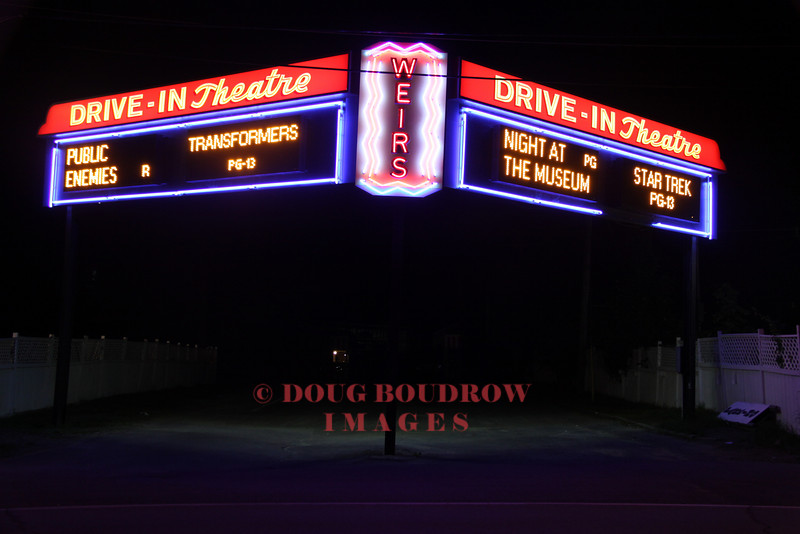 Laconia, NH - Drive in movies at Weirs Beach lit up at night, 7-9-09.