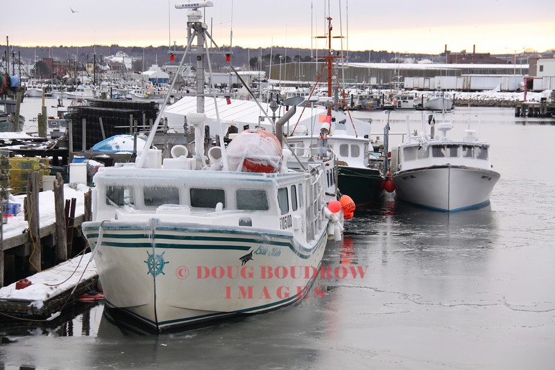 Gloucester, MA - Fishing boats sit at the dock in the frozen bay. Temperatures outside were almost single digits, 1-15-09.
