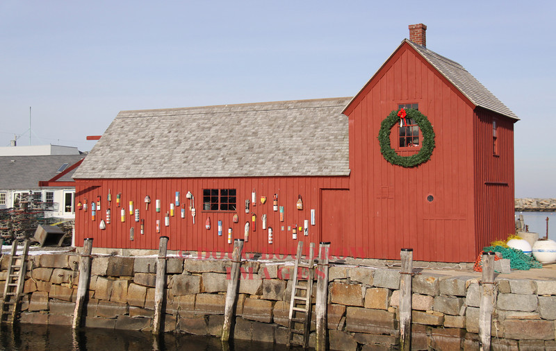 """Rockport, MA - This fishing shack is known by artists as """"Motif Number 1."""" The original shack, built in the 1840s was destroyed during the Blizzard of 1978 and the current building is an exact replica of the original, 1-17-09."""