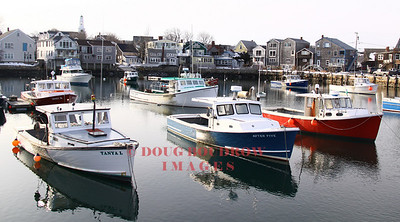 Rockport, MA - Several lobster boats sit moored in Rockport Harbor on this cold winter day, 1-17-09.