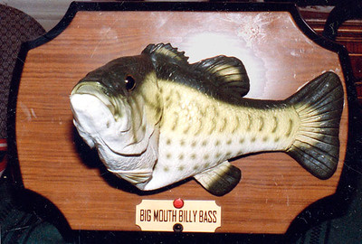 "The singing fish  - Big Mouth Billy Bass.  He sings ""take me to the river"" the first time you press the red button, and ""Don't worry be Happy"" - that is, the original singers are singing it... The fish slaps his tail and moves his head... I got him out after seeing those commercials that sprung up recently that are hilarious where the fish sings "" give me that fish filet, give me back that fish."" or something like it."