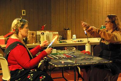 Jane teaches Katil to make glass beads
