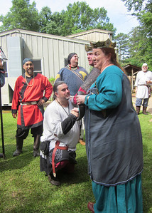Faelan called before the crown by the knights to be put on vigil.