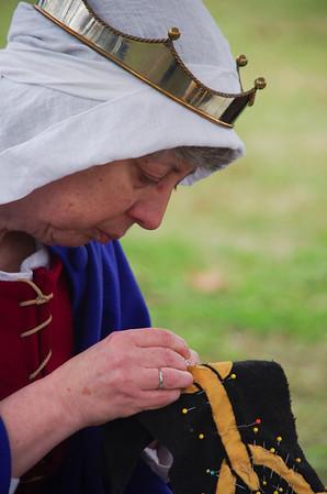 Judith working on the cloak