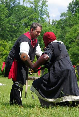 Ashi takes Roland as Man-at-arms