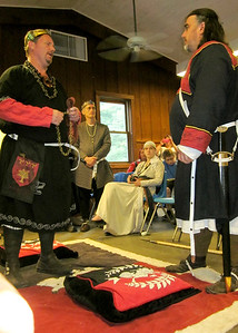 Duke Boru presents his squire Faelan with the chain of a knight