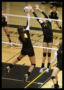 heather-ball-14-of-gilbert-high-school-hits-against-a-chaparral-players-block---9549_8069781458_o