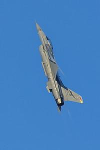 F-16 in a near vertical climb