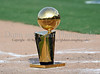 The Larry O'Brien Trophy occupies home plate at the Reebok 2011 Heroes Celebrity Baseball Event