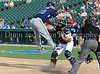 Former Texas Ranger Kevin Mench shows why sliding is the preferred way to avoid a tag during the Reebok 2011 Heroes Celebrity Baseball Event