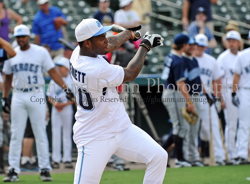 Dallas Cowboys tight end Martellus Bennett bats at the Reebok 2011 Heroes Celebrity Baseball Event