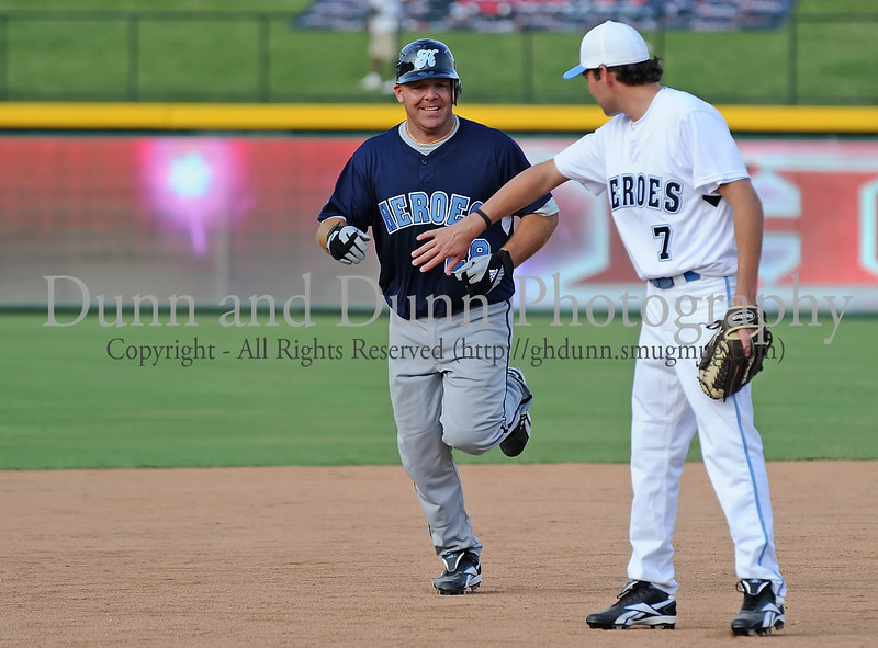 Former Texas Ranger Kevin Mench rounds the bases after hitting a home run in the Reebok 2011 Heroes Celebrity Baseball Event
