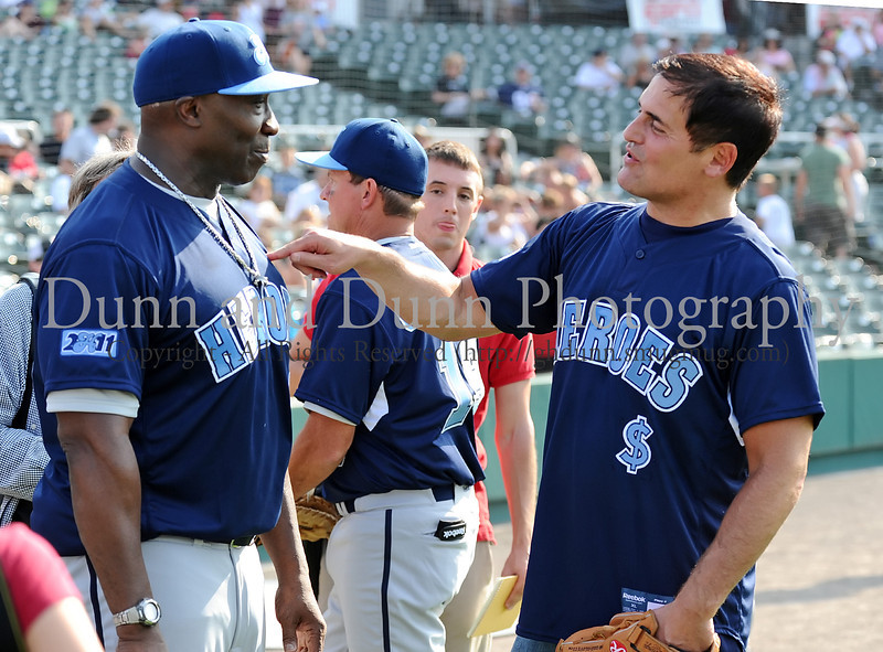 Actor Michael Clarke Duncan and Mavs owner Mark Cuban have a laugh at the Reebok 2011 Heroes Celebrity Baseball Event