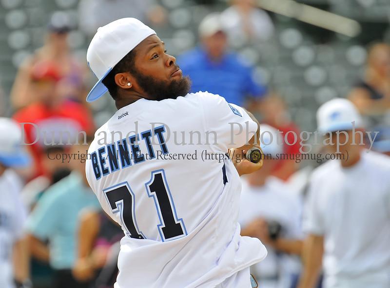 Tampa Bay Buccaneer Michael Bennett bats at the Reebok 2011 Heroes Celebrity Baseball Event