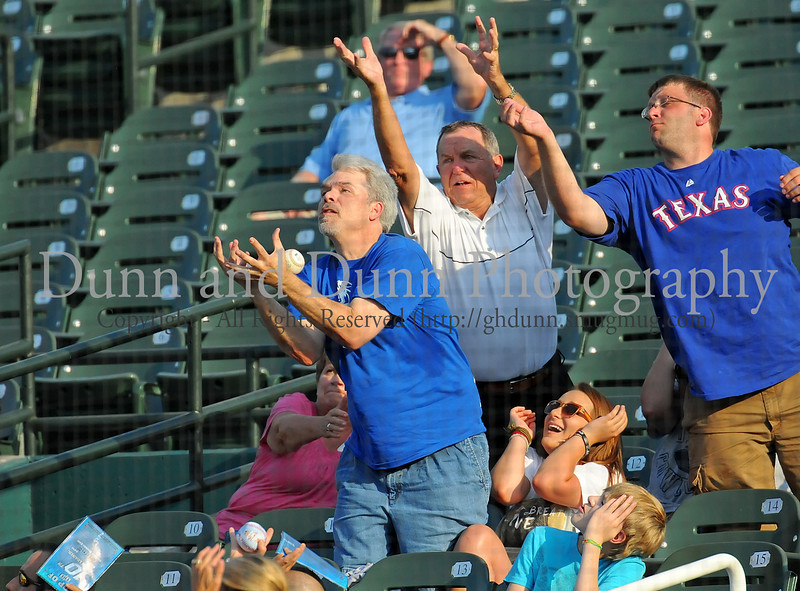 A fan snags a foul ball at the Reebok 2011 Heroes Celebrity Baseball Event
