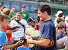 Mark Cuban signs autographs at the Reebok 2011 Heroes Celebrity Baseball Event