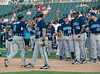 Kevin Boscamp is congratulated by teammates after hitting a home run in the Reebok 2011 Heroes Celebrity Baseball Event