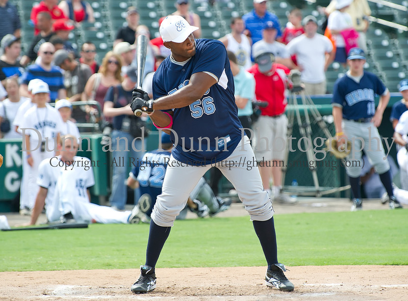 Dallas Cowboy Bradie James bats at the Reebok 2011 Heroes Celebrity Baseball Event