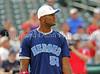 Dallas Cowboys linebacker Bradie James prepares to bat at the Reebok 2011 Heroes Celebrity Baseball Event