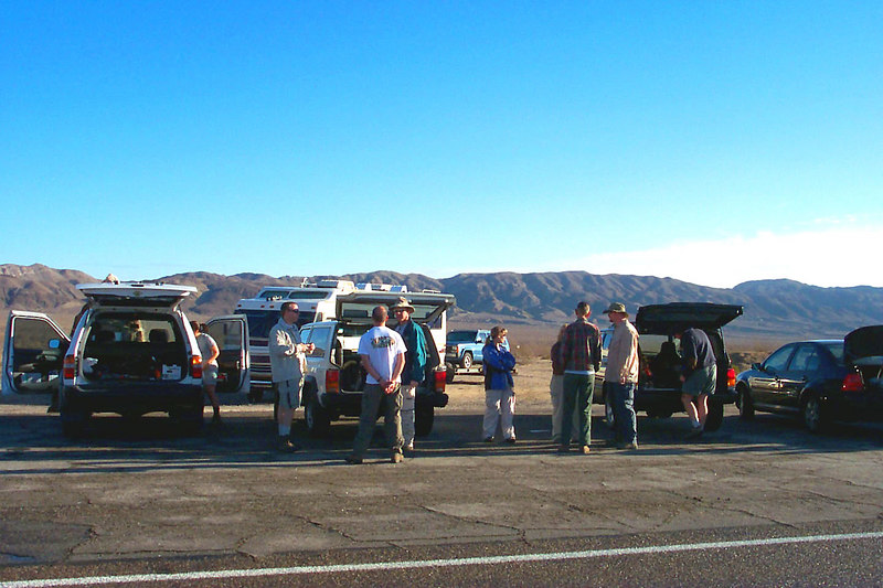 At the meeting spot, the group saying their hellos and working out a plan for the car shuttle.