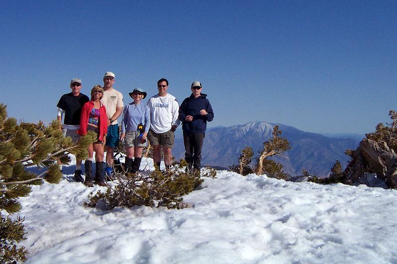 Group shot on Dobbs Peak at 10,459 feet with San Jacinto peak in the background.