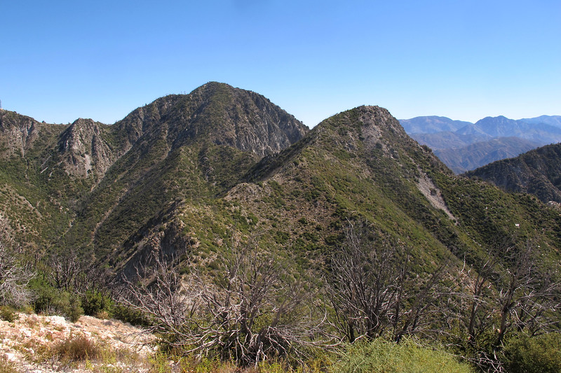 To the northeast, the higher one is San Gabriel Peak 6,161, and  Mount Markham 5,742'. In the distance is Twin Peaks at 7,596' and 7,761'.