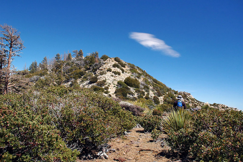 On the saddle and heading for the peak. We been watching that lenticular cloud forming for a couple of hours.