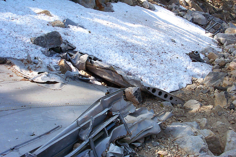 The other wing and some other stuff were below the trail. Snow was still covering some of the wreckage.