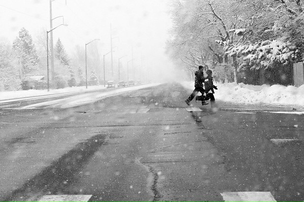 Winter photography in Fort Collins, CO of kids in the cold snow
