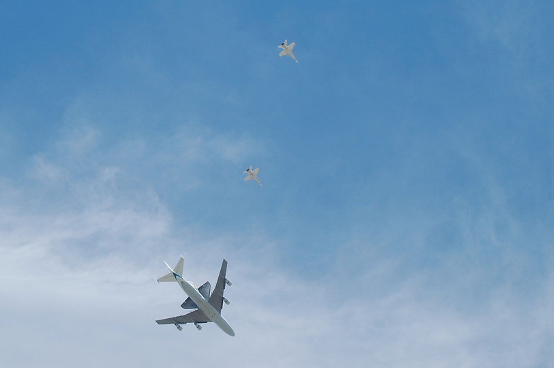 As the airplanes flew past, more of the Shuttle was starting to appear.