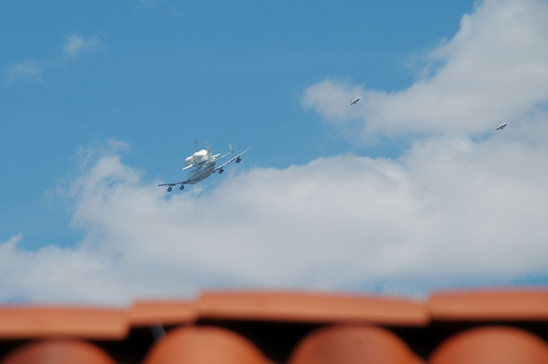 This is the best view I got of Endeavour just before the airplanes disappeared behind my neighbor's roof as they head northwest towards JPL. Great to see them fly so low over Pasadena.