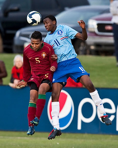 Two players from the Portugese and the Dutch U-17 National teams go for a header in Phoenix, AZ