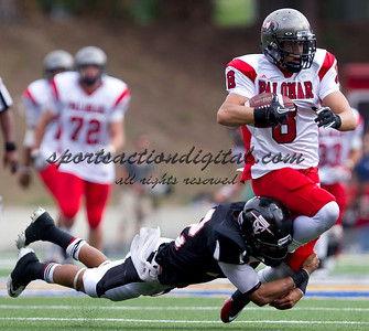 Kyle Greenwood (8) is tackled by Anthony Daniel (12).  Santa Ana played Palomar in a game that Santa Ana won in overtime 52-45.
