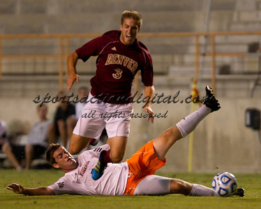 Kellen Christensen (3) is tackled by Michael Denny (5).  Cal State Fullerton beat Denver University 4-2 at Titan Stadium, Fullerton.