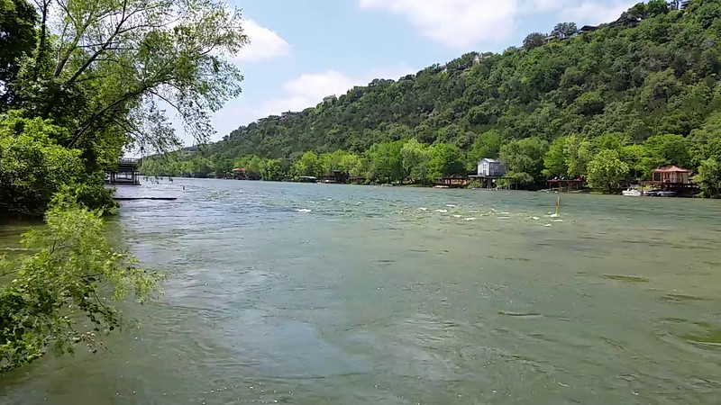 VIDEO !  - Meanwhile on Lake Austin, downstream about 1/4 mile, windy, noisy  - - - water flow at a neighbor's dock. Water level up about two feet. 4/25/2016