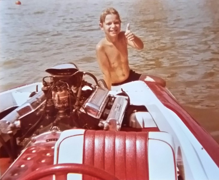 My 14 foot flat bottom boat with 350 cu.in. Chevy small block engine. 75 mph.  That's Paul Slack, my brother's stepson, who turned out to be a very successful business man. Time flies...Picture taken in about 1975.
